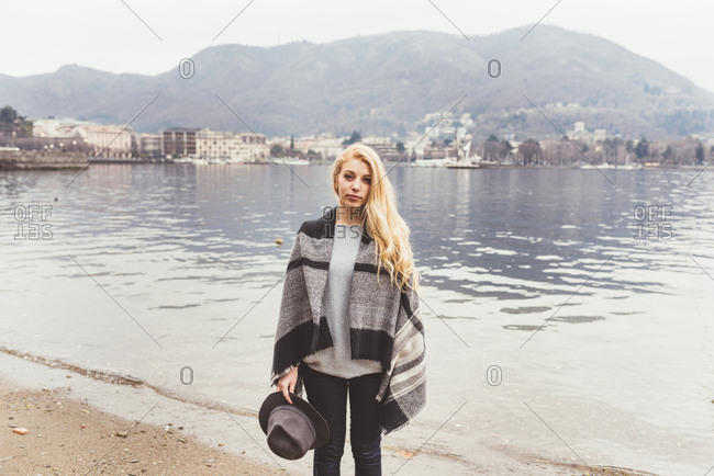 Portrait of stylish young woman on lakeside, Lake Como, Italy