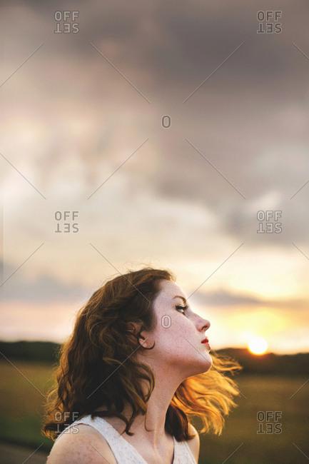 Woman in field looking away