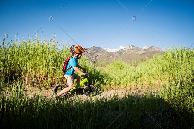 Boy cycling in park, Sandy, Utah, USA
