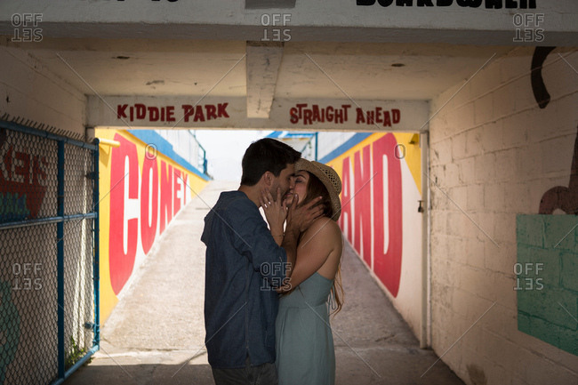 Couple in tunnel kissing, Coney island, Brooklyn, New York, USA