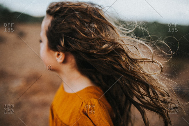 A girl with windblown hair