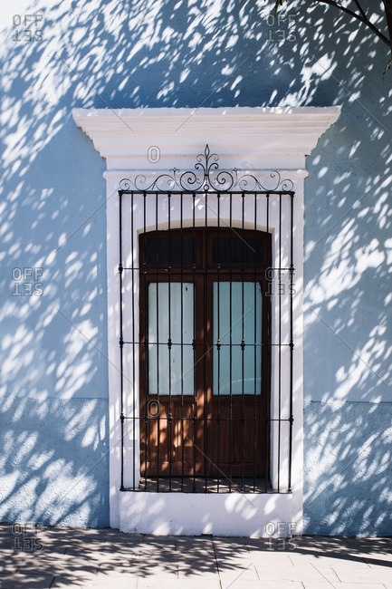 Doorway in shadow in Oaxaca de Juarez, Mexico