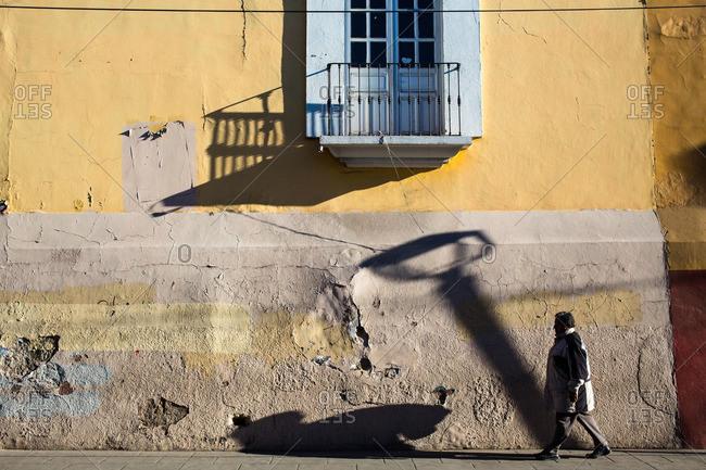 2/9/16: Man walking along a street in Oaxaca de Juarez, Mexico