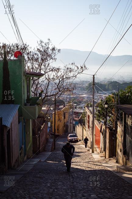 2/13/16: Man walking down a narrow street in Oaxaca de Juarez, Mexico
