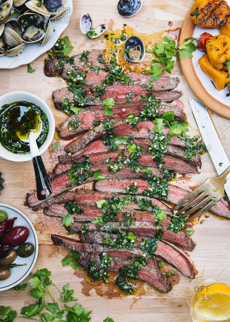 Flank steak with chimichurri served on a table