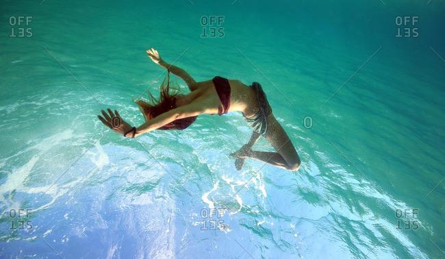 Woman in movement in sea