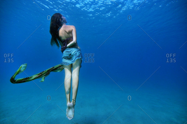 Woman rising to ocean's surface
