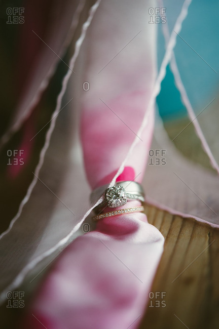Close-up of a wedding ring and engagement ring