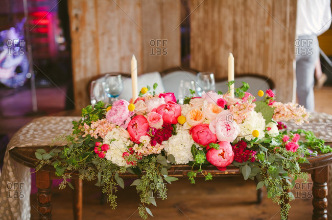 Floral centerpiece on a table at a barn wedding