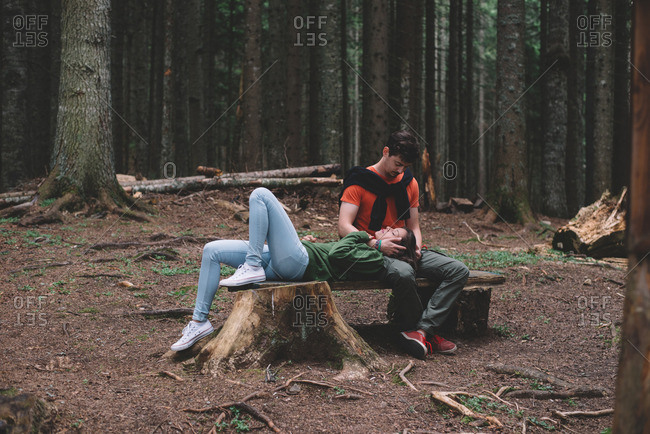 Couple on bench in forest
