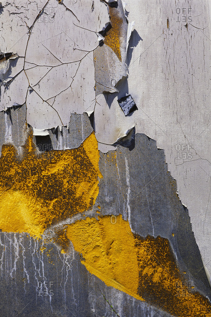 Detail of peeling and cracked paint on an old silo wall