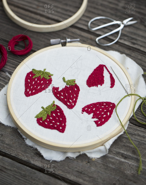 Needlepoint strawberries in an embroidery hoop