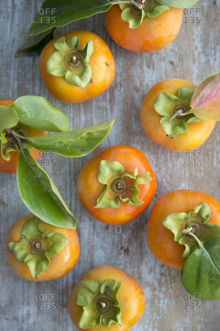 Overhead view of Fuyu persimmons on wooden table