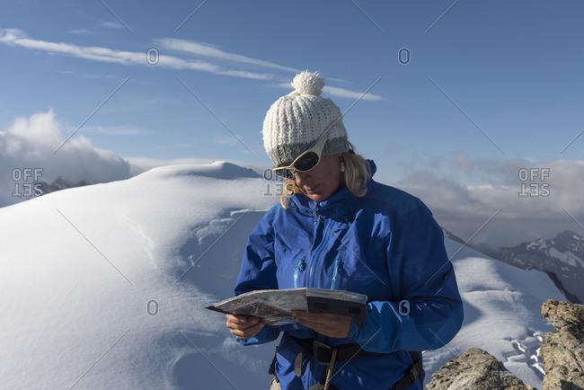 Switzerland, Woman looking at map at Bertol Hut