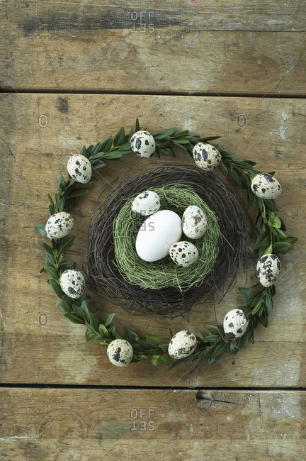 Easter wreath and Easter nest with goose egg and quail eggs