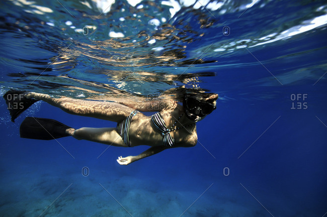 Young woman snorkeling in the ocean