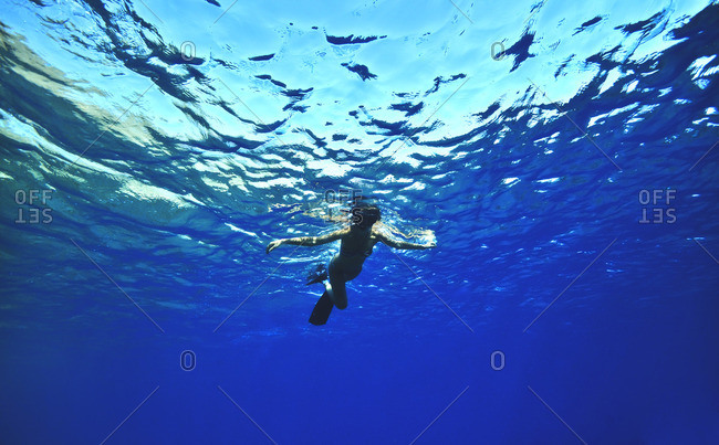 Young woman snorkeling at the ocean's surface