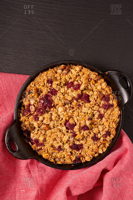 Berry oatmeal crisp served in cast-iron cookware