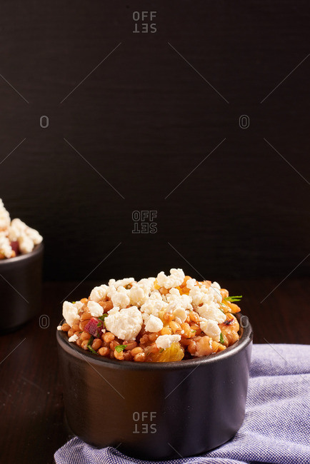 Goat cheese and wheat berry mix served in a ramekin