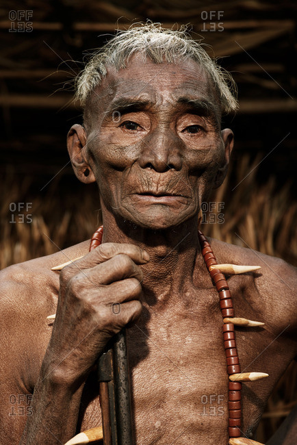 Nagaland, India - January 22, 2016: A Konyak man holding a stick