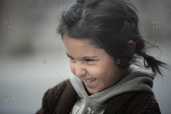 Cappadocia, Turkey - May 01, 2014: Incidental Turkish girl in the streets of Goreme, Cappadocia