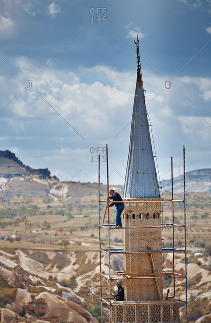 Cappadocia, Turkey - May 02, 2014: People working on mosque reconstruction