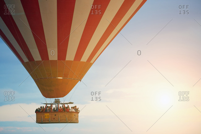 Cappadocia, Turkey - May 03, 2014: People in hot air balloons at Cappadocia area known as one of the best places to fly with hot air balloons
