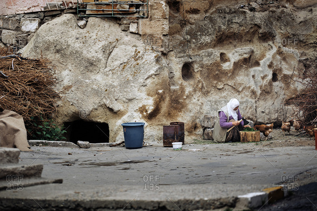 Cappadocia, Turkey - May 07, 2014: Senior Turkish woman preparing spice and food