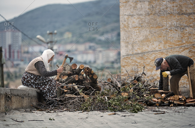 Cappadocia, Turkey - May 07, 2014: Senior Turkish man and woman preparing firewood