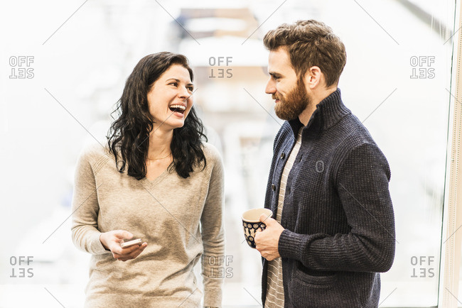 Two co-workers talking at the office
