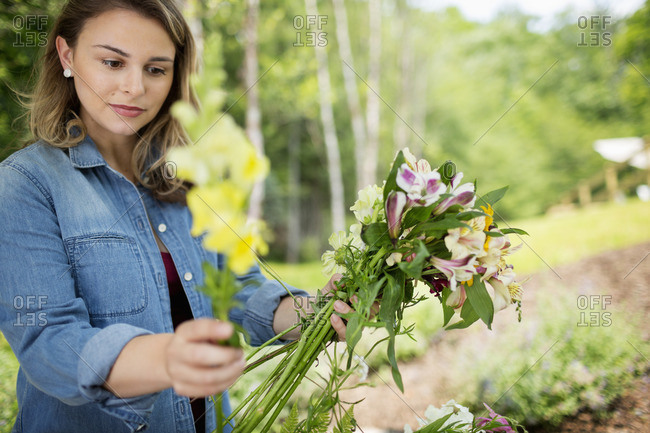 A woman holding a bunch of summer garden flowers