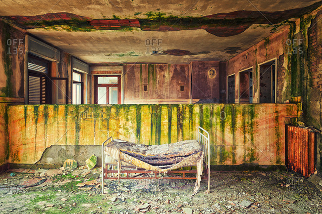 Child's bed in an abandoned hospital