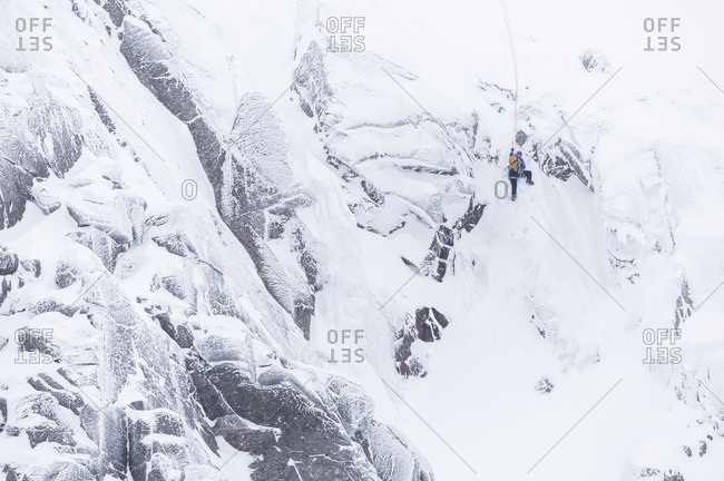 Ice Climber on the wall in the Cairngorms, Highlands, Scotland, UK.