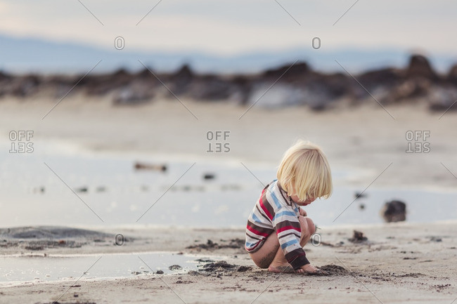 Toddler boy digging in the sand, Great Salt Lake, Utah
