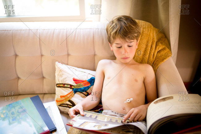Boy reading with gastric device