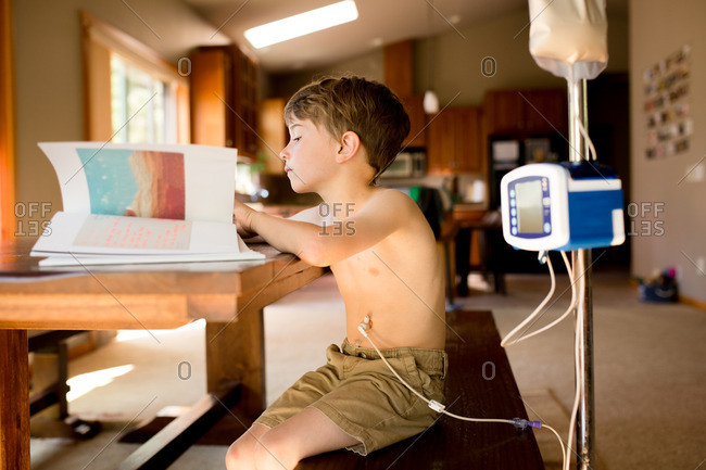 Boy reading using gastric pump