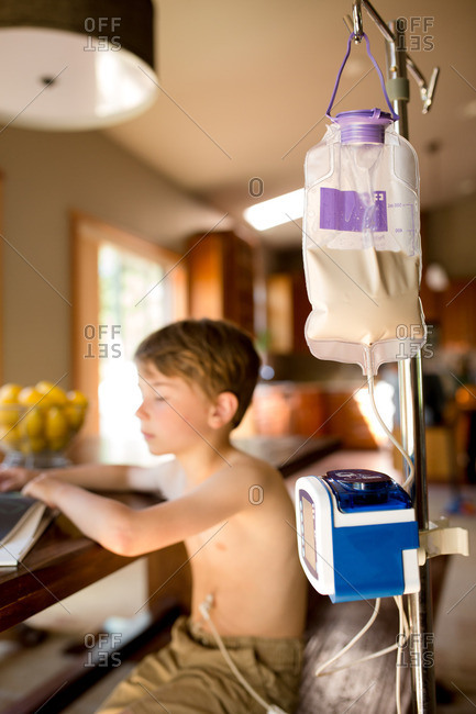 Gastric pump with boy in background
