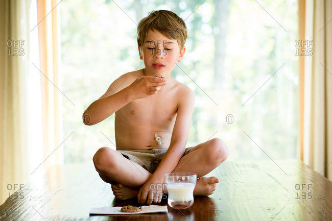 Boy with gastric tube eating snack
