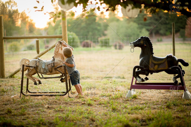 Boy looking at bouncy horse toy
