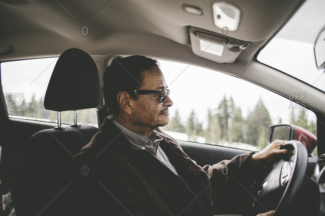 Middle-aged man driving a car a car