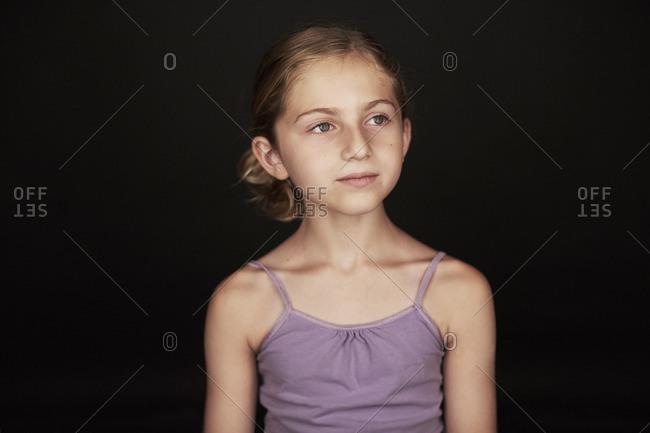 Portrait of a little girl wearing a purple tank top