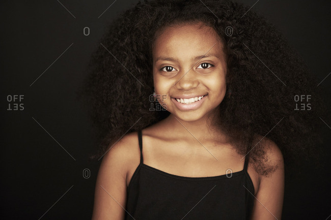 Portrait of an African American girl wearing a black tank top