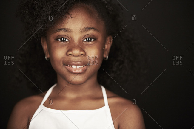 Portrait of an African American girl wearing a white tank top