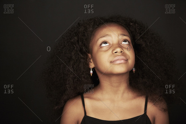 Portrait of an African American girl looking up