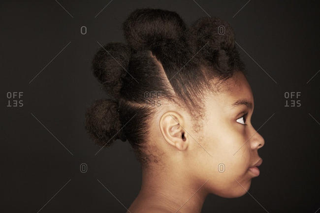 Profile portrait of an African American girl with her hair in buns