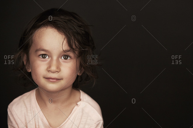 Portrait of a little boy with curly brown hair