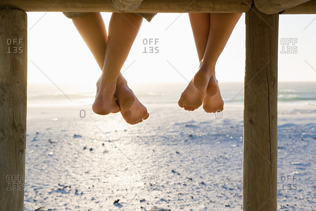 Barefeet and a pier - Offset