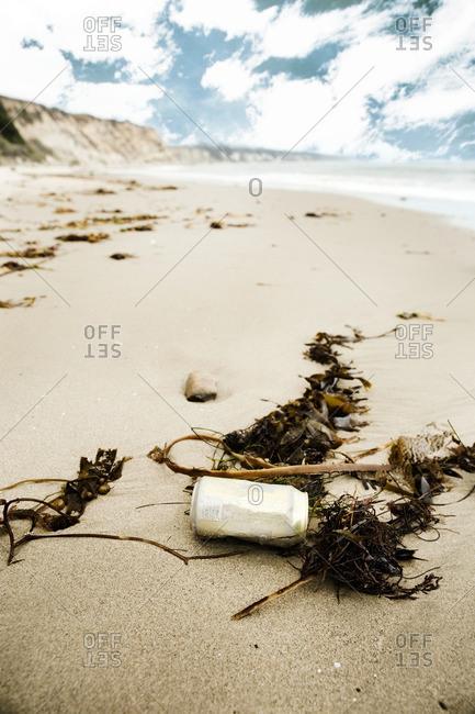 Discarded can on a sandy beach