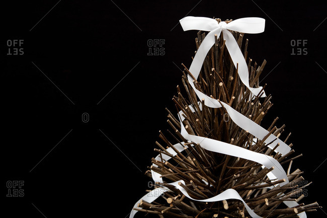 A ribbon on a bare Christmas tree