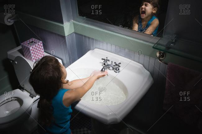 Girl splashing water - Offset Collection
